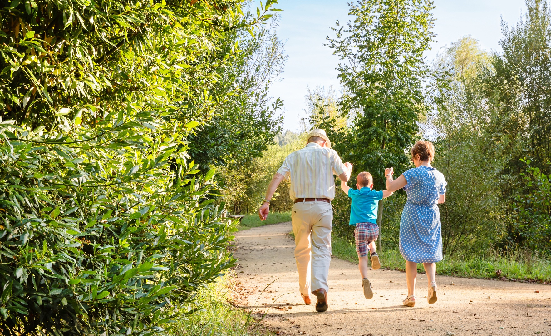 Grandparents walking with child