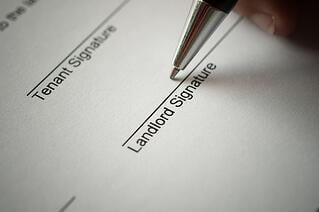 Landlord-signing-contract-lease-agreement