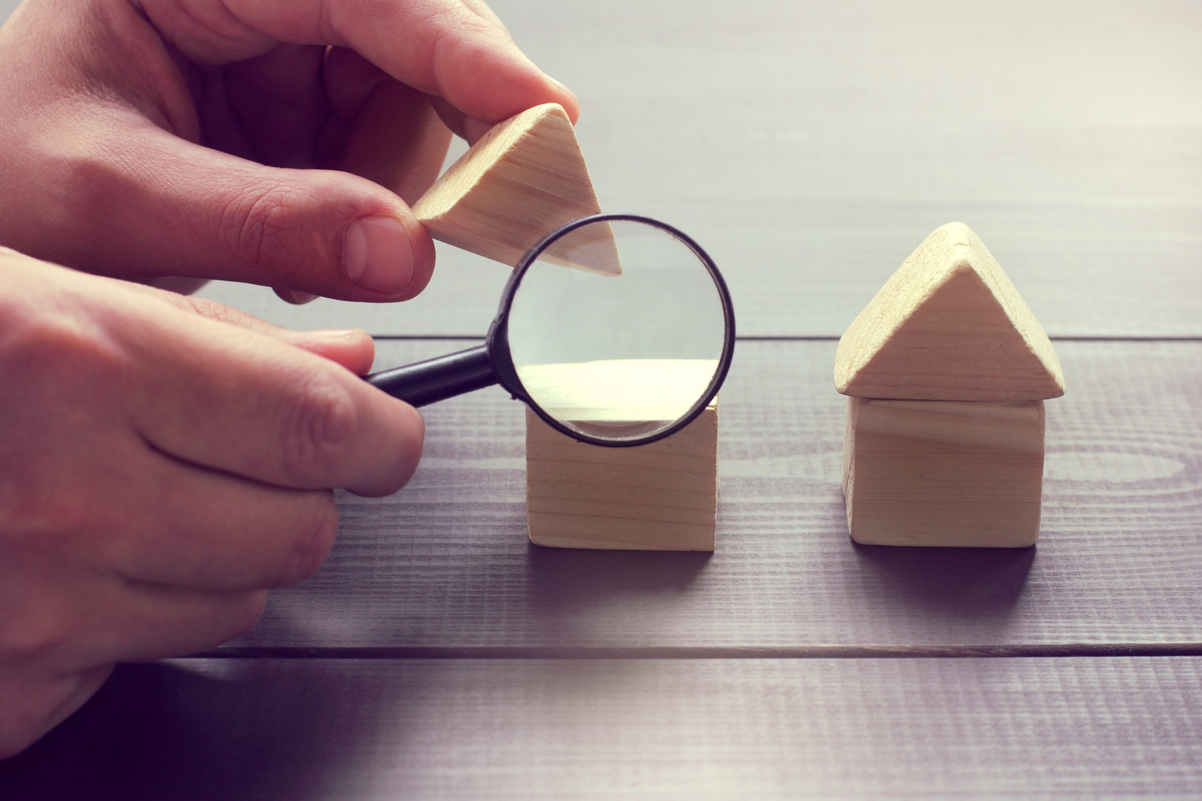 Magnifying wooden toy houses